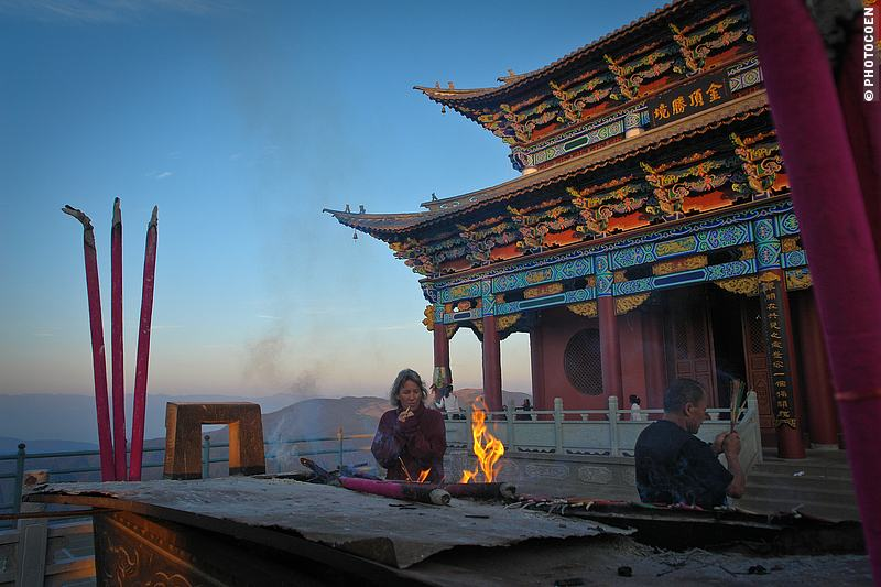 Hiking Mount Jizu; here warming up at a bonfire in front of the temple.