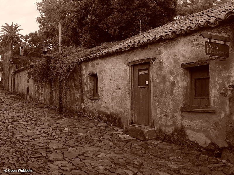 Colonia del Sacramento; here a sepia photo with cobbled street and old, small houses