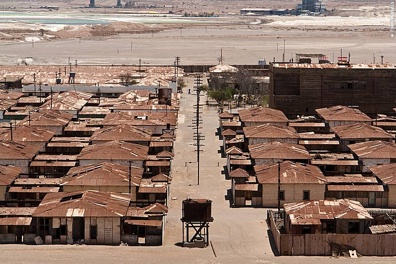 Humberstone: a view of a grid of wooden buildings with aluminium roofing in the desert