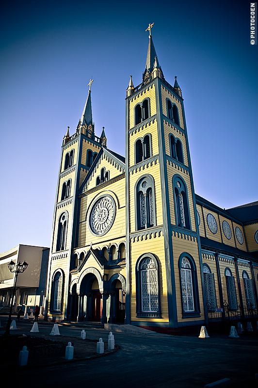 St Peter and Paul Cathedral in Paramaribo, yellow and grey wood on the outside.