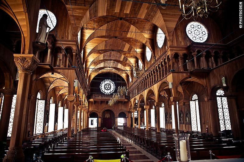Wooden cathedral in Paramaribo with intricate carvings.