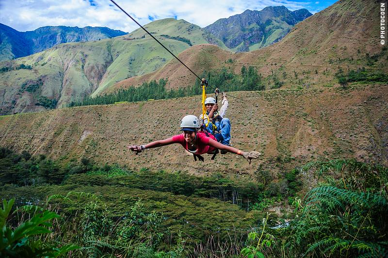 Ziplining in Peru at Cola de Mono Lodge - zipping like Superman on one of the 7 zipline cables.